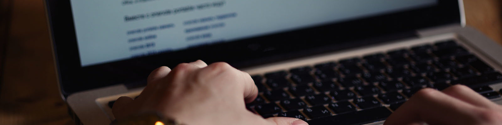 Graphic: What is doxxing? Photo of a man looking up info about another person online
