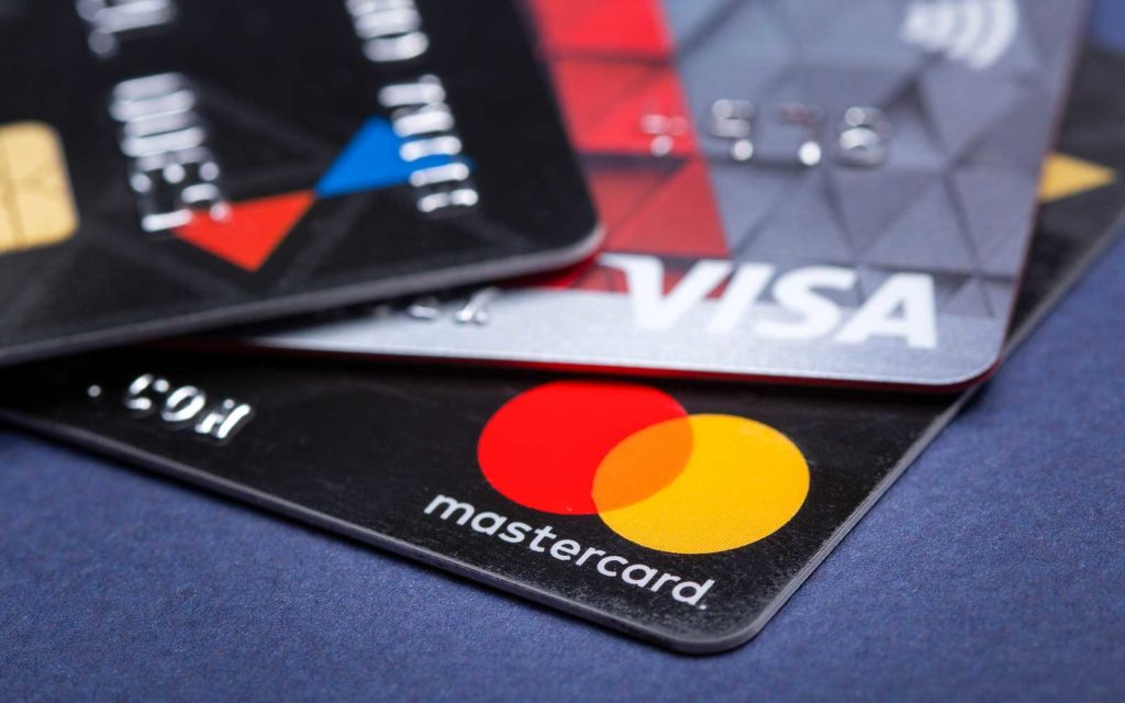 PCI merchant compliance levels graphic: A close-up photo of credit cards that showcases their logos