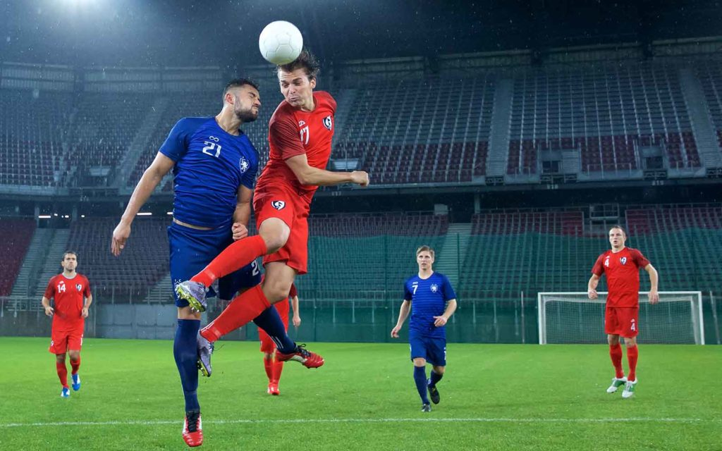 A photo of a red team vs blue team soccer match to illustrate the cybersecurity concept of pitting the two teams against each other